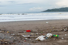 Rubbish on a beach after a storm Stock Images