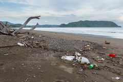 Rubbish on a beach after a storm Royalty Free Stock Image