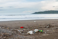 Rubbish on a beach after a storm Royalty Free Stock Photo