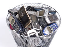 Rubbish bin. Full of old cellphones Royalty Free Stock Photo