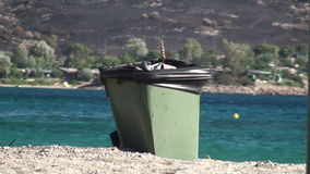 Rubbish Bin at Beach. Keep the beach clean. Throw your trash in the rubbish bin stock video footage