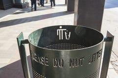 Rubbish bin on city sidewalk Stock Image