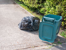 Rubbish and bin outside house stock photography