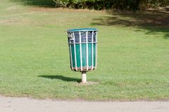 Rubbish bin in park. To keep the area clean Royalty Free Stock Image