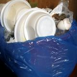 Rubbish Bin And Plastic Bag. Rubbish bin with plastic bag and various household items, Indoor closeup shot Royalty Free Stock Image