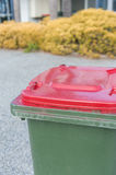 Rubbish bin with red lid Stock Photo