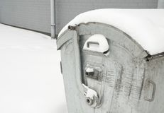 Rubbish bin in the snow Stock Images