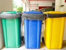Rubbish bins. In car park Stock Photo