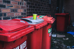 Rubbish bins and litter. Litter and rubbish bins on a side street Stock Photography