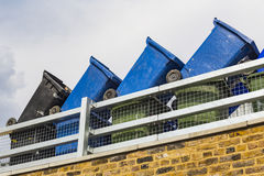 Rubbish Bins. Stacked in a row, Regent& x27;s Canal, London Royalty Free Stock Image