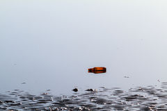 Rubbish Bottle in Water Royalty Free Stock Image