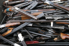 Rubbish of the broken and old shotguns, rifles. Rubbish container with broken shotguns, rifles and other old weapon Royalty Free Stock Photo