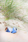 Rubbish can left at the beach Stock Photography