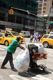 Rubbish collector New York. Man collecting rubbish in New York Royalty Free Stock Image