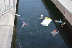 Rubbish Coming Ashore Stock Photo