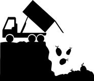 Rubbish Disposal Site. A silhouette of a garbage truck which is unloading trash bags into a landfill Stock Photography