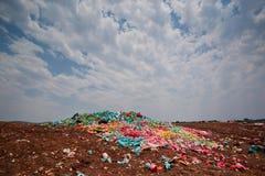 Rubbish dump. Dumped domestic rubbish and discarded plastic bags Stock Photo