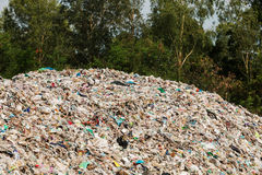 Rubbish dump. Uncontrolled disposal site in the nature Royalty Free Stock Photos