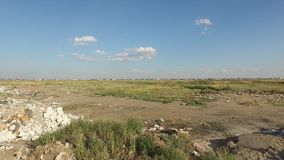 Rubbish dump in the veld. Near the big city. Dump and garbage stock video footage