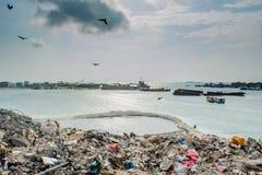Rubbish dump view full of smoke, litter, plastic bottles,rubbish and trash at the Thilafushi local tropical island. Rubbish dump zone view  full of smoke,litter Stock Photos