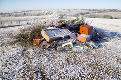 Rubbish on a field. Ecology, mess, winter Royalty Free Stock Image