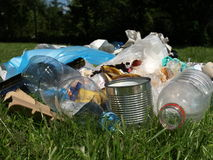 Rubbish in forest Stock Images