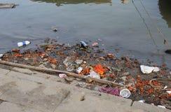 Ganges river pollution Varanasi India. Rubbish on Ganges river bank in Varanasi India Royalty Free Stock Photography