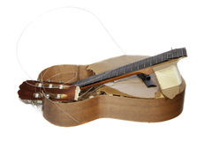 Rubbish Guitar Broken into Pieces Royalty Free Stock Photo