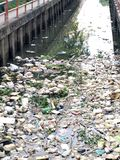 Rubbish heap are floating on canal Stock Images