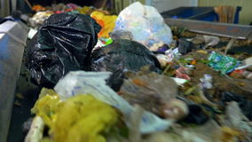 Rubbish, litter on a working sorting conveyor belt in a recycling plant. stock video