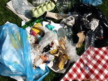 Rubbish in the open air. Plastic bags, bottles, paper Stock Image