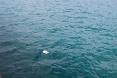 Rubbish  over the sea shows the sea pollution Stock Photography