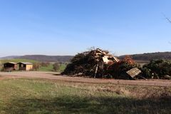 Rubbish pile built by townspeople in preparation for the annual bonfire. Rubbish pile built in late winter/early spring by the local townspeople in the village stock image