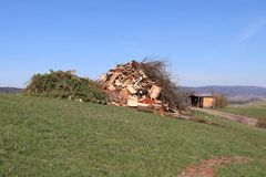 Rubbish pile built by townspeople in preparation for annual bonfire. A rubbish pile built in the late winter/early spring in the village of Potzbach, Germany in stock photos