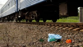 Rubbish on the railway thrown out of the train window, pollution, railway and litter royalty free stock photography