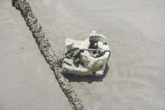 Rubbish on the sand. Beach Stock Photos