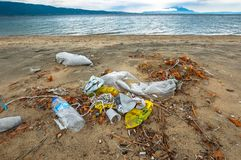 Rubbish on the shores of an ocean Royalty Free Stock Image