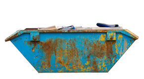 Rubbish and trash in and around a skip isolated Stock Photography