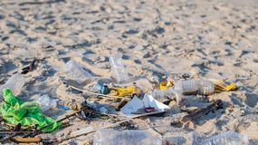 Rubbish and used plastic bottles on the beach. Environmental pollution. Ecological problem. Trash and used plastic bottles on the beach. Environmental pollution stock image