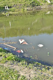 Rubbish, waste floating in polluted pond Stock Photo