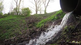 Rubbish and water sewer pipe stock video footage