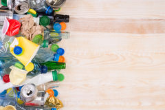 Rubbish on wooden background with copy space Royalty Free Stock Images