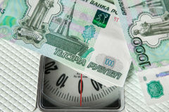 Rubble banknotes on the on the scales Stock Photo