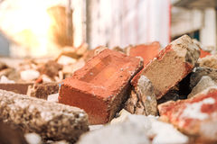 Rubble in container. With sun rays Royalty Free Stock Photography