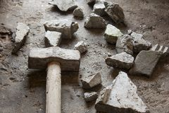 Rubble debris with hammer Stock Photography