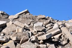 Rubble From a Demolished Building. A large pile of broken concrete from an old building royalty free stock photo