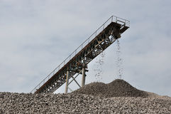 The conveyor is conveying of gravel. Engineering construction using Royalty Free Stock Images