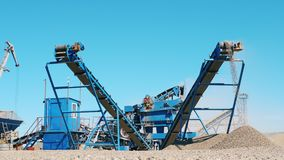 Rubble is getting ground by grinding machines. Mining equipment at quarry. Rubble is getting ground by grinding machines. 4K stock footage