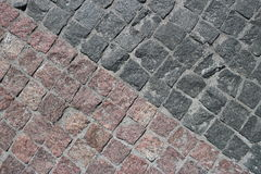 Rubble gray and brown square stones paved road Stock Images