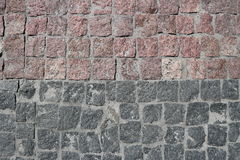 Rubble gray and brown square stones paved road. With a horizontal border Stock Photography